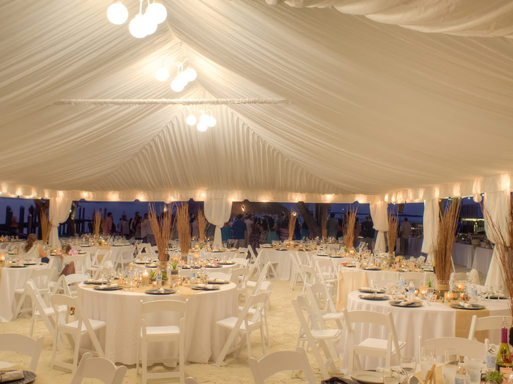 Deluxe cloth tent liner, white curtain leggings for poles, and globe chandelier.