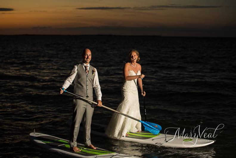 Intimate beach wedding in The Keys - Bride and Groom Paddle Board in Florida Keys sunset light.