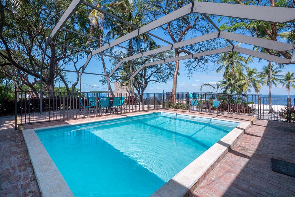 Pool, beach house wedding in Florida