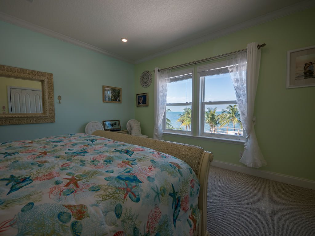 Bedroom #4 - Bridal Suite. King bed with direct water view.