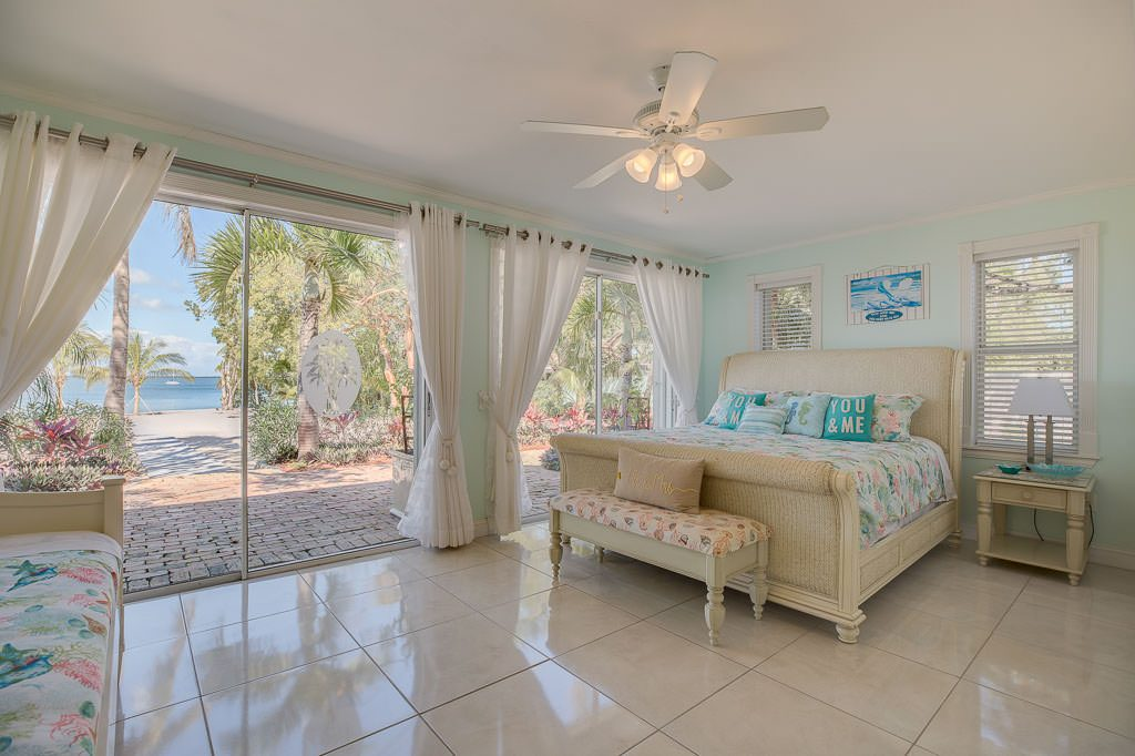 This is the main Bride's Room. Notice the trundle bed and king bed. This is a feeling you can only get from a top beach house wedding venue.