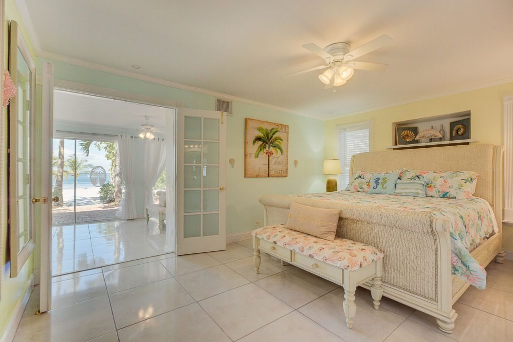 This is the Bridesmaid's Room. It adjoins the Bride's Room through the french doors to create one huge dressing area for you and your bride's maids to prepare on wedding day. Notice the view from the beach house all the way to the ceremony area.