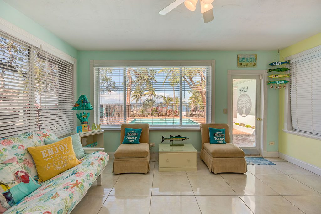 The sun-room with futon is located between the pool and the kitchen. It boasts a very large shower and bathroom to accommodate guests using the beach or pool. This is probably the most popular room in the entire beach house.
