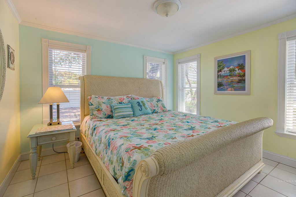 On the opposite side of the beach house are the groom's bedrooms. The Groom has two king sized bedrooms on the opposite sides of the house from the bride's suite. This is Groom's Bedroom #1.